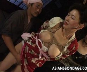 Bound Japanese MILF groans while her pussy is teased - 7 min